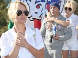 Stand by your man: Pamela Anderson clings to boyfriend before he attempts to run from Vegas to LA in stilts