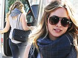 Hilary Duff shows off her post-pregnancy body in a pair of size 26 jeans...and then treats herself to another pair