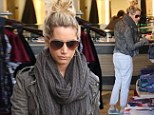 Feeling long in the seat? Ashley Tisdale keeps her legs under wraps in saggy trousers... on shopping trip to Planet Blue