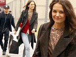 Sugar rush: Katie Holmes arrives at the matinee performance of her Broadway play with a fortifying supply of cupcakes