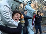 One Direction lark about in New York for homemade video...and Harry Styles get a hug from the Statue of Liberty