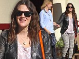 A bold move! Drew Barrymore goes undercover in camouflage as she slips back into skinny jeans 10 weeks after giving birth