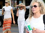'Mom, you still look like you're 17... it's embarrassing standing next to you!' Ireland Baldwin and Kim Basinger wear matching T-shirts as they celebrate her 59th birthday