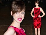 Pretty as a petal! Porcelain doll Anne Hathaway stands out in red floral dress... after interview with Les Miserables co-stars