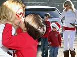 After the drama: Brandi Glanville kisses her sons before picking out 'the perfect Christmas tree'