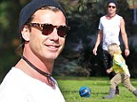 Gavin Rossdale takes his children to the park for a kick around... the morning after performing with wife Gwen Stefani
