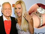Before the split: Playboy founder Hugh Hefner and his fiancee Crystal Harris celebrate his 85th birthday in Las Vegas on April 9, 2011 - two months before she ended their first engagement
