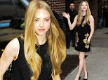 Chic shift: Leggy Amanda Seyfried displays her very slim pins in a Sixties-style black and gold mini dress