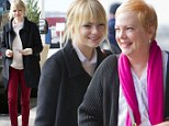 The apple doesn't fall far from the tree! Emma Stone and her strawberry blonde mother Krista flash same trademark grin