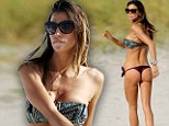 Feel the burn! Paraguayan model Claudia Galanti gets in a quick workout on Miami beach in front of an admiring audience