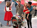 Festive fashionista! Alyson Hannigan decks her three-year-old tot in red frock and ruby slippers... for family outing at The Grove