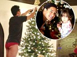 So cheeky! Mario Lopez's wife Courtney Mazza tweeted a picture of the TV host decorating the Christmas tree in his underwear with his daughter's assistance