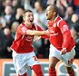 Nottingham Forest's Robert Earnshaw celebrates scoring his second goal of the game with Radoslaw Majewski
