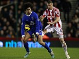 Ruthless Huth: Marouane Fellaini (left) is about to feel the full force of a Robert Huth challenge