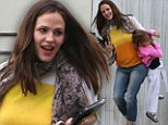 What a carry on! Jennifer Garner gives giggling daughter Seraphina a lift to karate class