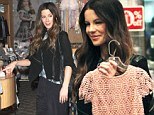 Kate Beckinsale goes Christmas shopping for posh children's clothes in stylish all black get up