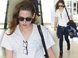Goodbye glamour, hello grunge! Kristen Stewart is back to her laid-back self as she leaves New York after daring red carpet turn