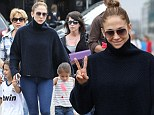 She's just Jenny from the yacht! La Lopez keeps covered for boat trip with her gorgeous twins