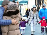 Back in the arms of her baby: Sarah Jessica Parker and Matthew Broderick put on rare PDA as they step out with their girls after actress's Oslo drama
