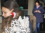 All tuckered out: Hands-on mother Katie Holmes cuddles sleepy Suri ahead of a play date with her new friend