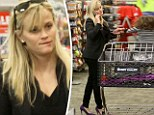 Trolley dash! Reese Witherspoon gamely does her own Xmas shopping... and all in fancy high heels, too