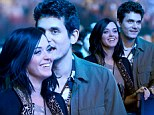 Sweet nothings: John Mayer whispers into Katy Perry's ear as the cute couple spend date night at a Rolling Stones concert