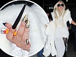 The 26-year-old stood out wearing a snow white ensemble which included a highly structured white mini dress with a long train and exaggerated shoulders, a matching fur coat and sky-high black stilettos.