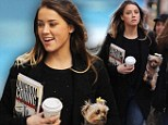 Never far from her side! Amber Heard is joined by her furry companion Pistol as she film scenes for her new movie