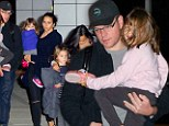 Bourne by daddy! Matt Damon carries tired daughter after touching down in New York