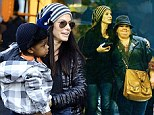 Sandra Bullock gives her little man Louis a lift as she joins 'new best friend' Melissa McCarthy on magical Disneyland day out