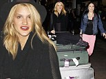 Ashley Roberts returns to the US after time in the UK
