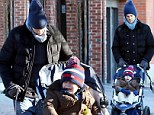 Tom Brady and son Benjamin take a break from the girls on father and son stroll