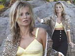 Rock chic! Kate Moss poses on a stone in lemon coloured bra and high waisted skirt on glamorous photoshoot in St Barts
