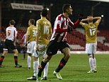How's that? Marcello Trotta of Brentford celebrates his second goal against Arsenal's conquerors
