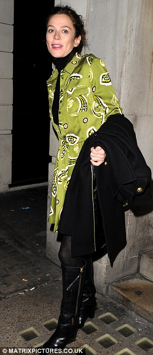 Preserving her modesty: Luckily Anna didn't reveal too much as she was wearing a black polo neck top underneath the dress