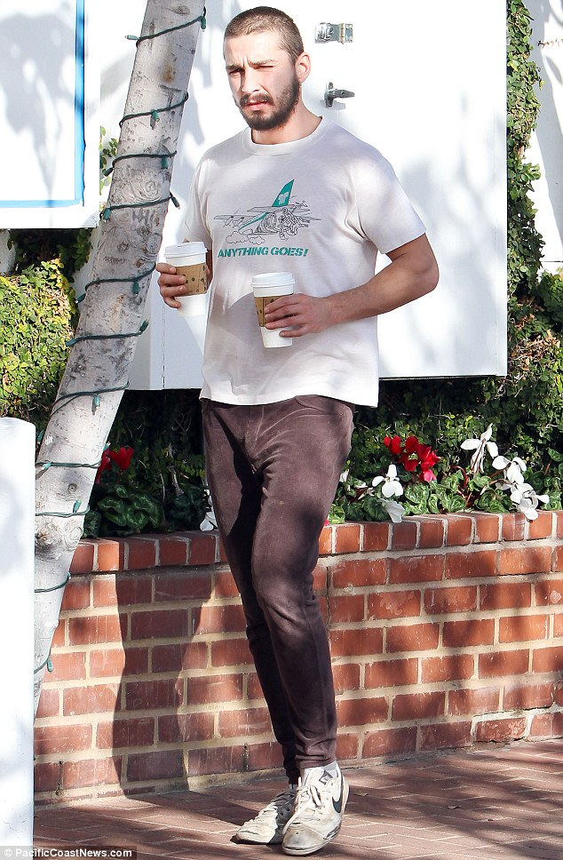 All by himself: Though he carried two coffees, Shia kept his distance