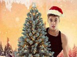 O Christmas Tree! Justin Bieber shows off his festive green as the battle for the biggest and brightest timber begins