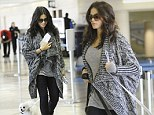 A new addition to the maternity wardrobe? Pregnant Jenna Dewan-Tatum is swamped by her oversized cardigan as she touches down in LA with her dogs