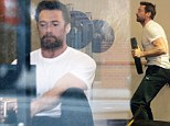 No rest for the weary! Hugh Jackman gets in a greulling Christmas Eve Workout