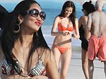 Russell Simmons gets sandy in the sun while on holiday with girlfriend Hana Nitsche