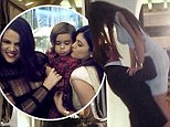 Kylie Jenner rocks around the Christmas tree with Scott Disick as Kardashians lead stars ringing in holiday with their families