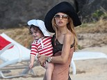 Nautical stripes! The famously thin 41-year-old was carrying her equally fashionable 21-month-old son, Skyler, who looked eager to get down and play in the surf
