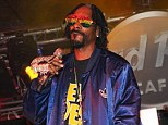 Christmas fun: Snoop Lion, performing in Vegas earlier this month, planned to watch the LA Lakers game with his family