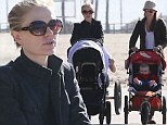 Anna Paquin takes her baby twins out for a walk with a friend in Venice Beach in California