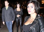 No room to breathe! Lorenzo Lamas finds himself in his wife's Shawna Craig's shadow as she sports daring leather ensemble