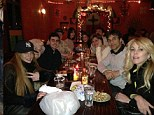 Lindsay Lohan appears to be sitting with an alcoholic drink in front of her at a family meal but sources claim it was in fact her grandmother's