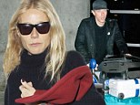 Gwyneth, Chris, Apple and Moses arrived at the airport in the afternoon in a chauffeur driven car and hurried unsmilingly into the terminal.