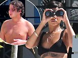 Pictured: Rihanna keeps watch with binoculars as police are called after man is caught trespassing at her Barbados villa