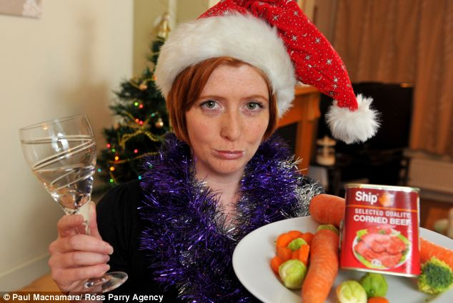 Festive frown: Becky Irvin will have to eat her meal of sprouts, carrots and corned beef and as gravy on the meal brings her out in a severe allergic reaction