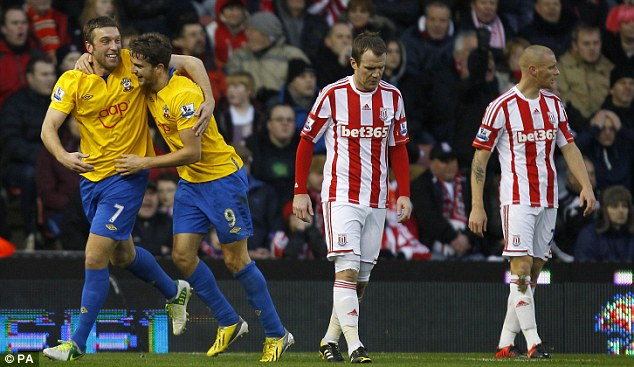 We'll take it: Lambert (far left) and Jay Rodriguez were celebrating after Andy Wilkinson's own goal